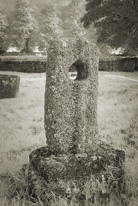 Holed cross stone