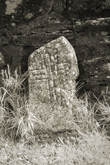 Cross inscribed stone