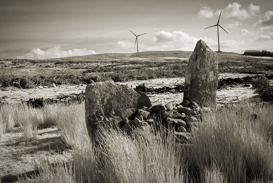 Ballymagaraghy Standing Stones with wind turbines in the background