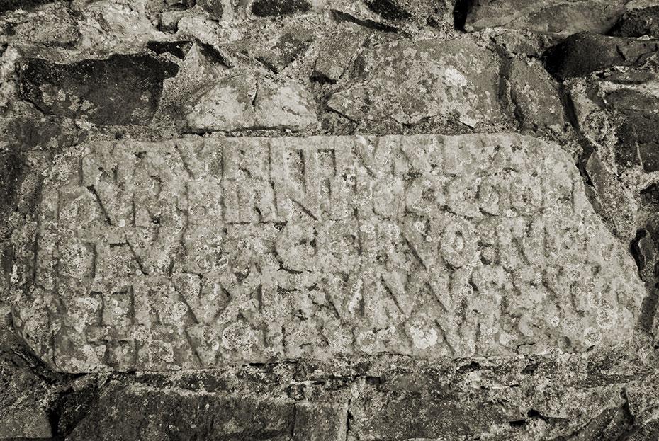 Latin inscription on stone set into south wall